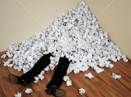 stock-photo-12198459-businessman-buried-in-mountain-of-crumpled-papers